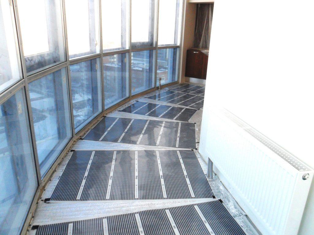Теплый инфракрасный пол на балконе с панорамными окнами